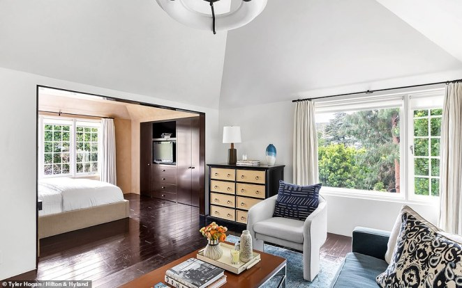 Wide open: The master bedroom has spacious vaulted ceilings. The home was built by the two-time Oscar winning actor Frederic March in 1934