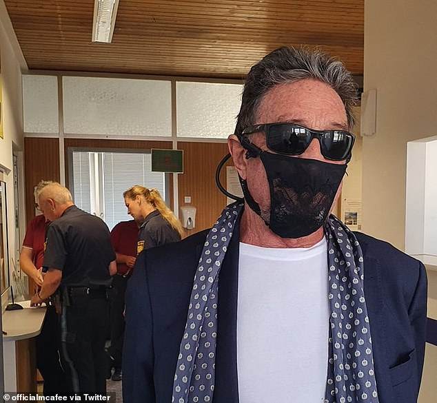 Tech tycoon John McAfee has apparently been arrested in Norway because he refused to put a medically-certified face covering over his thong mask (pictured)