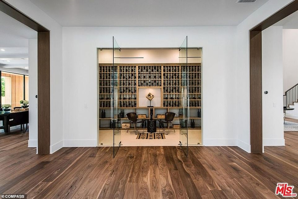 Protected: The wine cellar comes behind two glass doors opening out into the dining area
