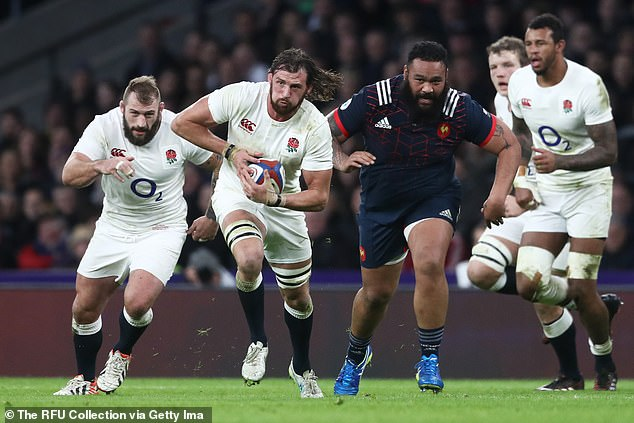 Wood runs with the ball during the Six Nations clash with France at Twickenham in 2017