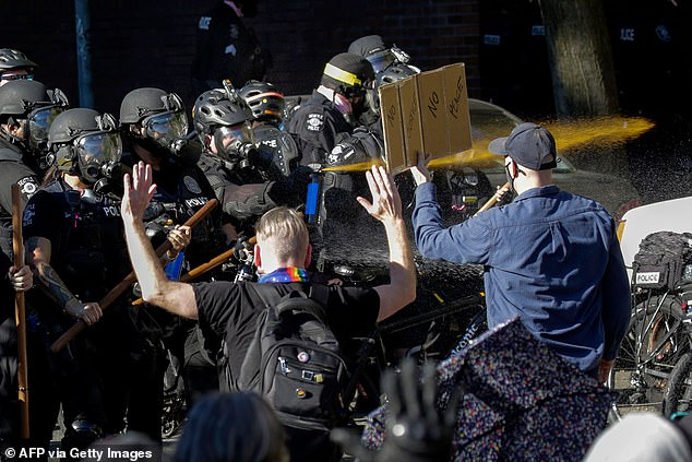 Best previously said any layoffs would disproportionately target newer officers, often hired from Black and brown communities, and would lead to lawsuits. Pictured,Seattle police officers deploy pepper spray as they clash with protesters following the Youth Day of Action and Solidarity with Portland demonstration on July 25