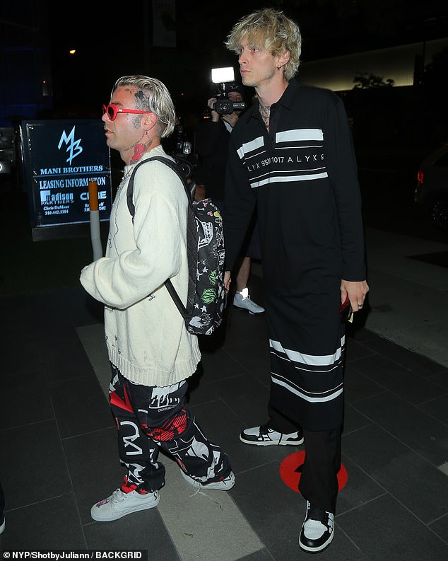 Doing damage: The Bloody Valentine hitmaker made his way towards the Steakhouse's entrance in a pair of black and white sneakers and he carried his red leopard print wallet in hand