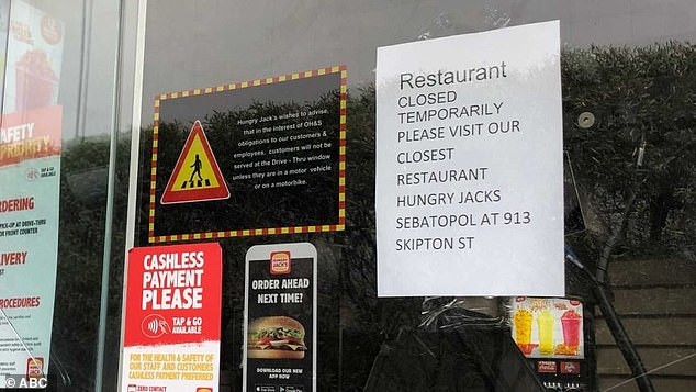 Hungry Jacks has closed the Bakery Hill and Wendouree stores, 113km west of Melbourne, after a staff member tested positive for COVID-19 on Monday (a sign posted on the door of the Wendouree store pictured)