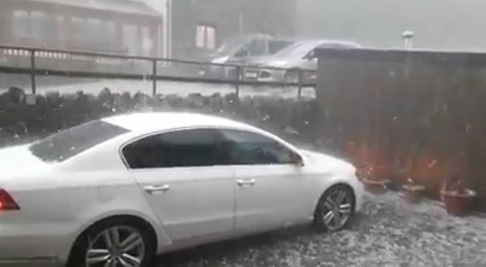Hail stones reported to be the size of golf balls set off car alarms as they fell over Capel Curig in North Wales yesterday