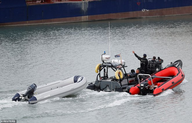 An inflatable boat used by migrants is brought by Border Forces crew at Dover harbour this morning after the migrants were already brought ashore