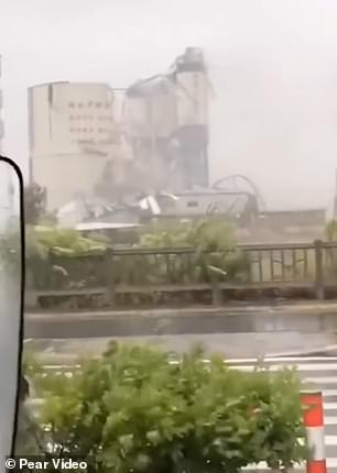 Footage shows a factory building in Longhai being torn down in seconds as onlookers watched in shock