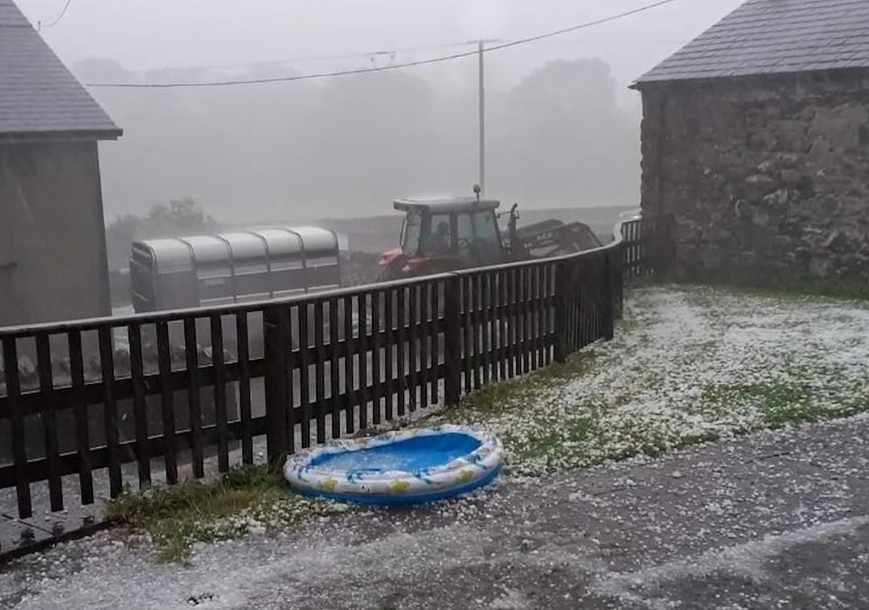 A hailstorm bucketed down over Capel Curig in North Wales yesterday afternoon as the heatwave in Wales started to end