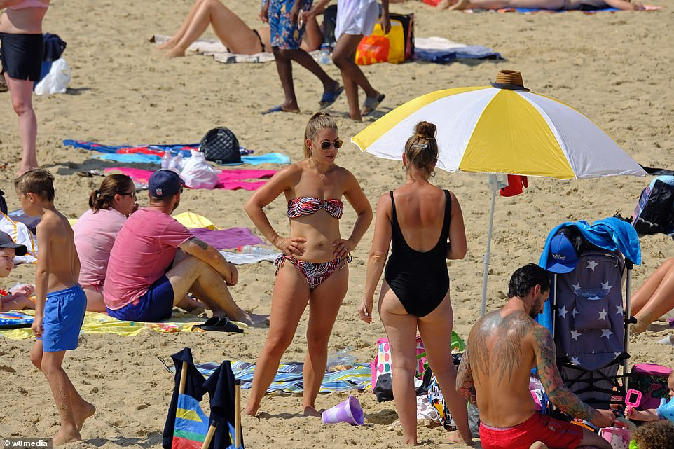 People make the most of the hot weather by visiting Bournemouth beach in Dorset today amid the ongoing heatwave