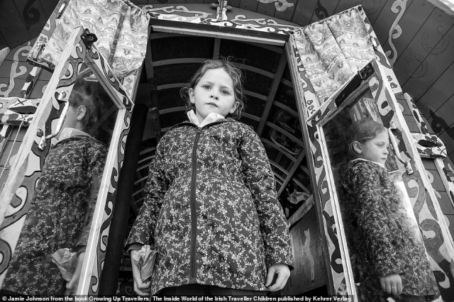 A young traveller girl stands at the back of a caravan in this picture by US-based photographer Jamie Johnson, who spent time getting to know a group of Irish travellers over the course of five years