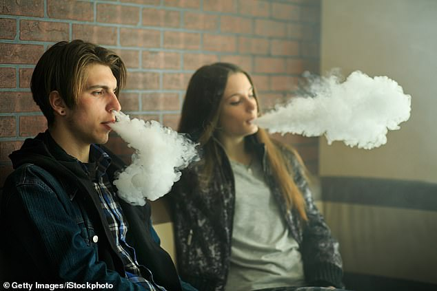 A pre-print of an Australian study suggests that cigarette smoke may trigger an uptick in proteins on human cell surfaces that act like doorways for coronavirus. Nicotine in e-cigs may well have the same effect, and one study found young vapers are at five-fold greater risk for COVID-19 (file)