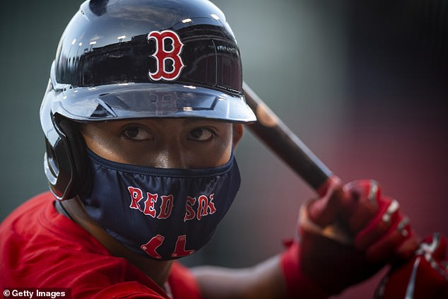 Tzu-Wei Lin of the Red Sox wears a mask as he looks on during an intrasquad game during a summer camp workout before the start of the 2020 Major League Baseball season on July 17
