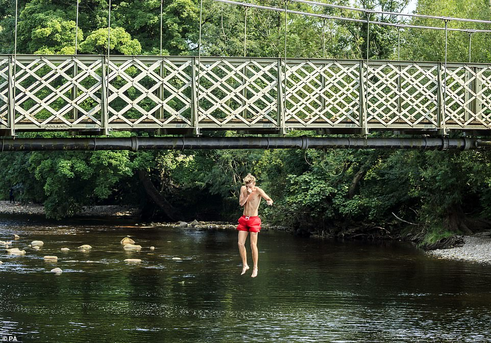 Another sun-seeker jumped from a narrow bridge as dozens of those across the UK raced to rivers and beaches to cool off