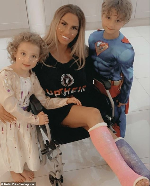 Family first: Katie is said to have been'devastated' about medical advice to 'stay in bed' as it was her youngest son Jett's birthday and she wanted to celebrate properly (pictured with her son and youngest daughter Bunny)