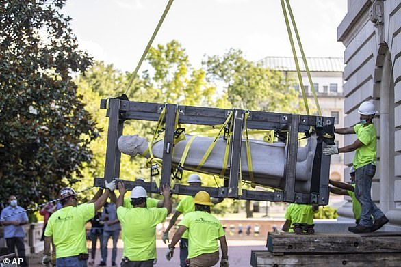 Workers hoist a statue of Jefferson Davis after removing it from the Kentucky state Capitol in Frankfort, Kentucky in early June