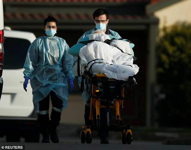 An elderly patient is removed from an aged care facility in Melbourne  on July 31