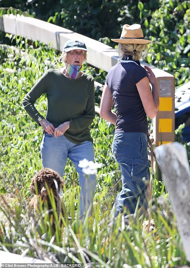 Shooting the breeze: Portia and her mom chat on the sunny day in the natural settings