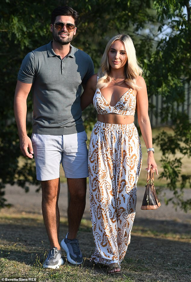 Her guy: TOWIE's Amber Turner looked incredible in a plunging bra top and matching palazzo pants as she cosied up to Dan Edgar during filming on Wednesday