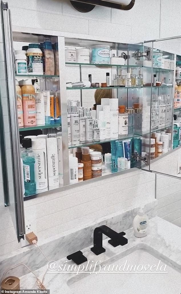 Nice: Professional movers and organizers helped her get her home in order, and she showed off the gleaming kitchen and a beautifully-organized medicine cabinet in her bathroom