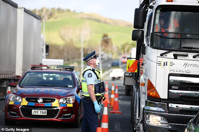 Police question drivers as they head in and out of Auckland on SH1 north of Wellsford on Wednesday (pictured) amid new Stage Three lockdown