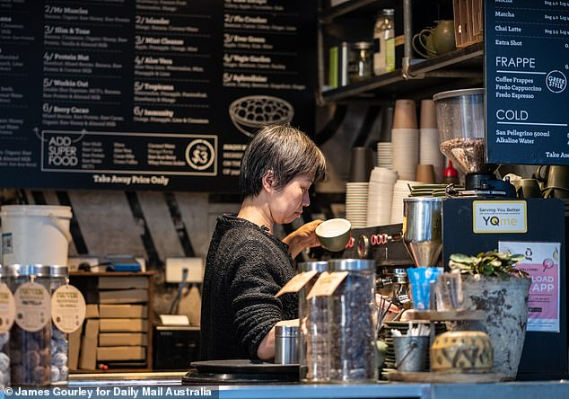 Australians need to earn more than $89,000 a year to be considered an above-average income earner. Pictured is a Sydney barista