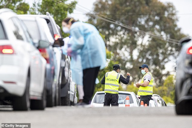 Health authorities are still working to identify the source of the cluster of cases at the Cherrybrook school (pictured security guards at pop up testing clinic in Castle Hill in Sydney on Wednesday)