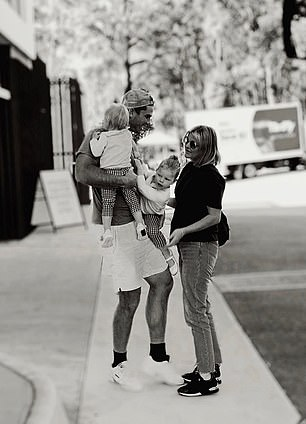 AFL star Tom Hawkins was pictured reuniting with his wife Emma and his two daughters Arabella and Primrose