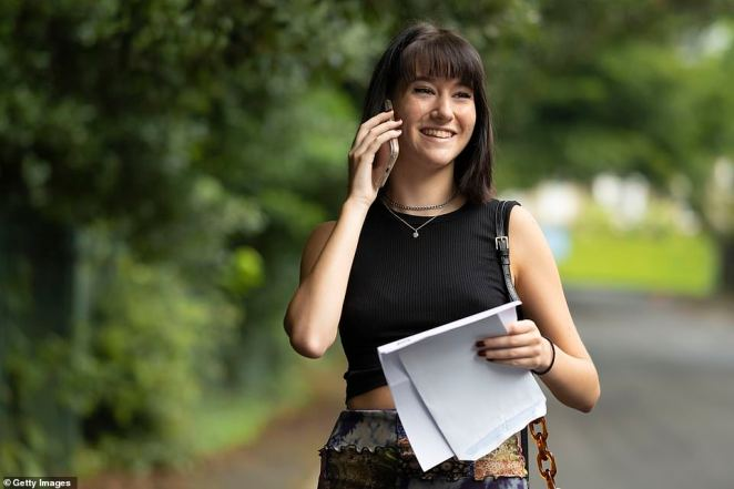 Holly Cuttiford with her A Level results at Ffynone House School in Swansea, South Wales, this morning