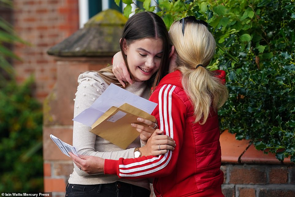 Poppy Gerrard, 18, reacts as she opens her A-Level results at West Kirby Grammar School on the Wirral today. Poppy, who is a Miss England contestant, got A*s in biology, chemistry and maths - and now hopes to take maths at Manchester University