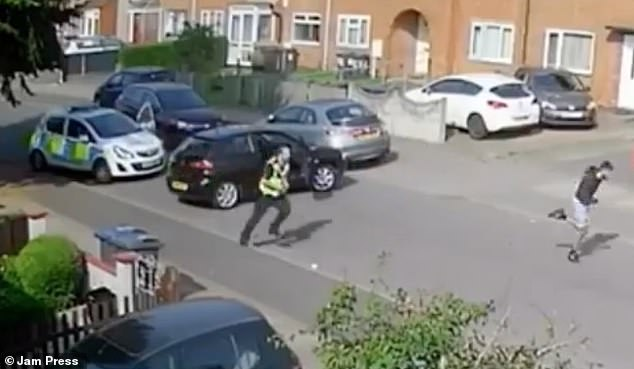 The youth makes a break for it in the hilarious CCTV footage in a street believed to be in Tyseley, Birmingham, on August 11 around 4:55pm