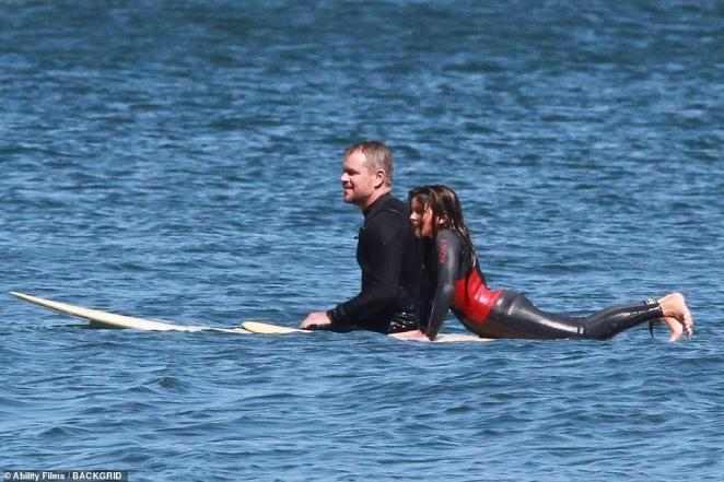 Waves: Damon hopped into the ocean with daughters Isabella, 14, and Gia, 11 (above)