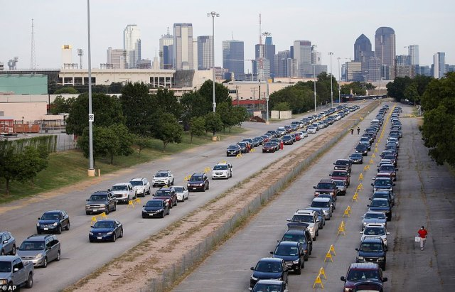 Cars lineup to get food during the North Teas Food Bank's fourth free food distribution at Fair Park in Dallas on Tuesday