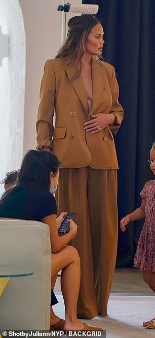 Business ready: She tried on wide leg mustard trousers and longline matching blazer