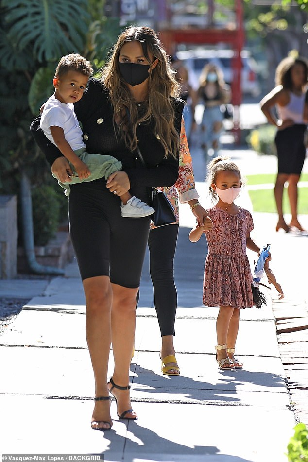 Family day: She was glowing as she was joined by Luna, four, and Miles, two, who she also shares with John