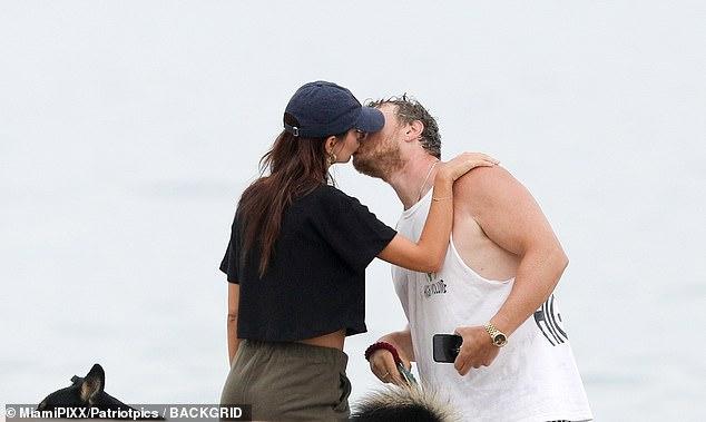 emily ratajkowski tenderly kisses her