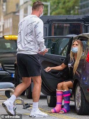What hero: Katie was seen transported by her loyal boyfriend Carl as she arrived at the hospital for major surgery on Friday morning fearing she would lose a leg
