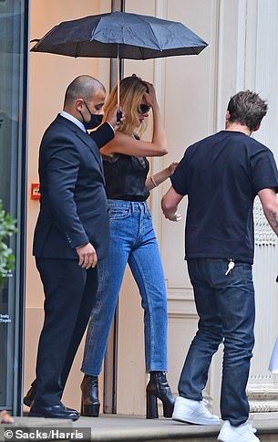 Stylish: Nicola wore a pair of high-waisted mom jeans with a black silk plunging camisole top
