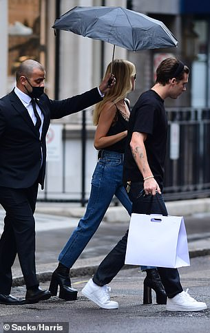 Dramatic! Adding some dramatic footwear, she opted for black platform heel boots and teamed her look with a gold necklace