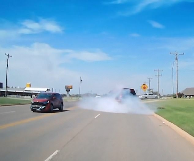 Footage shows the red SUV sidewipe the van inPiedmont, Oklahoma causing the van to swerve and crash into the curb