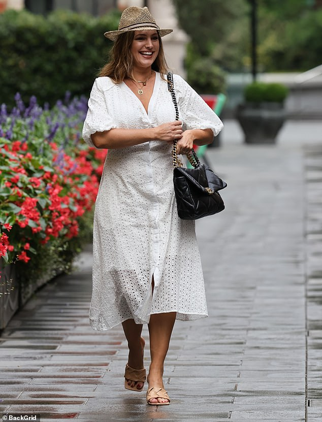 Stunning: Kelly donned a stylish fedora-style hat and accessorised with a Chanel handbag as she stepped out