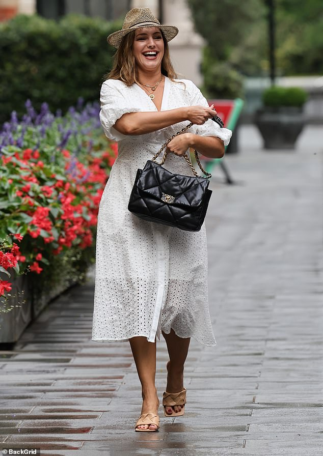 Happy: The radio presenter appeared to be in good spirits as she strutted along the street, despite recently revealingcruel trolls had branded her 'unsexy'