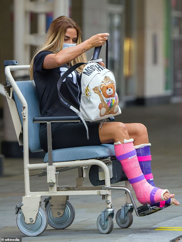 Low-key look: The mother-of-five kept it simple before her surgery, wearing cycling shorts and an oversized Fila t-shirt, and packed her things in a Moschino backpack