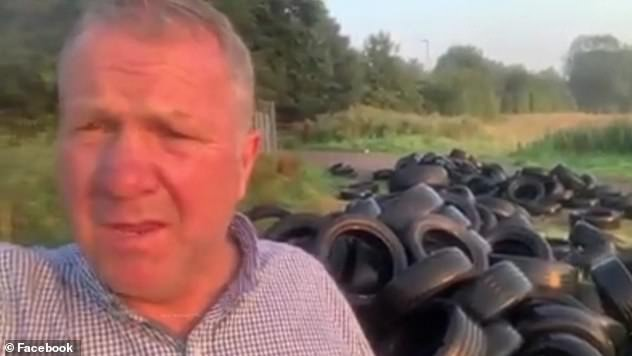 The landowner, pictured, filmed himself standing in front of a mound of tyres dumped on his land in Haydock, Liverpool