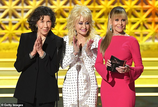Back in 2017, Parton (center) famously refused to partake in jabs against President Donald Trump when she appeared with her 9 To 5 co-stars Jane Fonda and Lily Tomlin at the Emmy Awards. Tomlin and Fonda have been outspoken critics of the Commander-in-chief