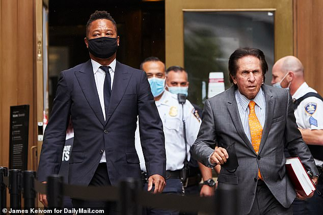 Exit: Gooding Jr. and his attorney, Mark Heller, leave Manhattan Supreme Court on Thursday