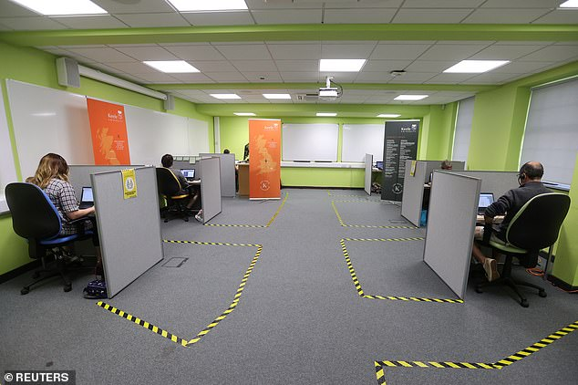 Socially-distanced workers at the Keele University call centre handle calls from students on the A Level results day