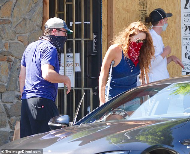 Protected:Hamm wore a navy blue bandana-style face covering, as face masks remain mandatory while out in public in Los Angeles, while Osceola wore one in a bright red