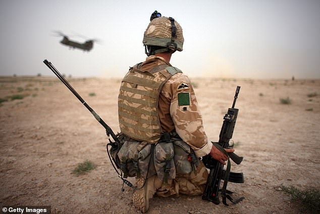 A British Army soldier from the 3rd Battalion The Parachute Regiment secures the helicopter landing strip (HLS) during operation Southern Beast on August 6, 2008 in Maywand District in Kandahar Province, Afghanistan