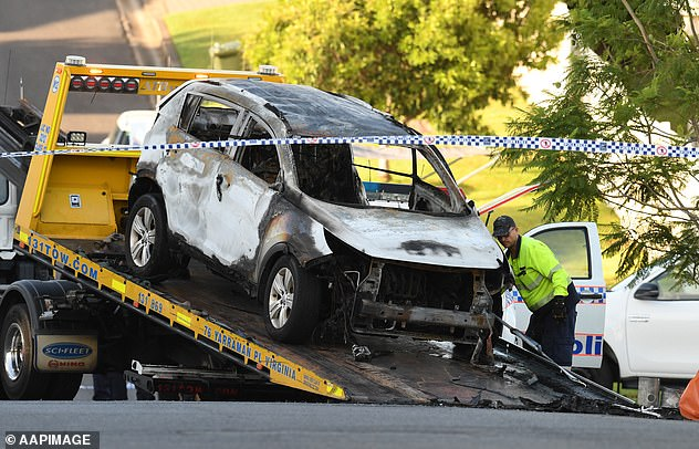 Pictured: A tow truck removes the car Baxter burnt in Brisbane on February 19, 2020