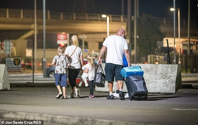 Families made a last-minute dash across the Channel last night ahead of the 4am cut-off this morning when France was added to the UK's quarantine list. Pictured: A family arriving from Dieppe last night