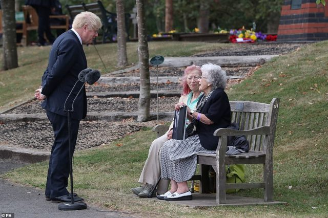 Prime Minister Boris Johnson speaks with Jane Elgey, nee Reid, who was in Singapore when it fell, and her daughter Glynis Elgey, at the national service of remembrance marking the 75th anniversary of VJ Day at the National Memorial Arboretum in Alrewas, Staffordshire